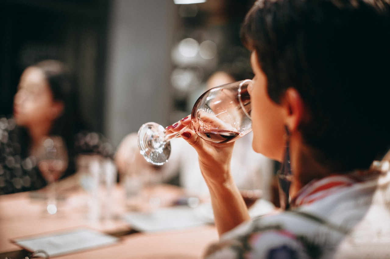 Woman drinking a glass of red wine